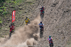 High energy as multiple riders race up the hill at the same time at the Gunstock Hillclimbs during Laconia Motorcycle Week. NH, USA. Wednesday, June 13, 2018. Photography ©2018 Michael Lichter.