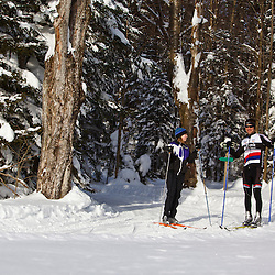A man and woman cross-country skiing at the Notchview Reservation in Windsor, Massachusetts. The Trustees of Reservations.
