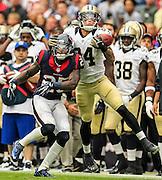 Aug 25, 2013; Houston, TX, USA; Houston Texans wide receiver Kenny Stills (84) catches a pass over Houston Texans cornerback Kareem Jackson (25) during the first half at Reliant Stadium. Mandatory Credit: Thomas Campbell