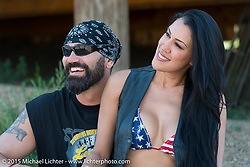 Dawn Pollard with her husband and retired NBA player Scott Pollard (the two make 13' of fun!) at the Spur Creek Ranch for the annual Lichter/Sugar Bear Ride during the 75th Annual Sturgis Black Hills Motorcycle Rally.  SD, USA.  August 5, 2015.  Photography ©2015 Michael Lichter.