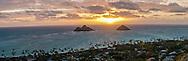 Sun rising behind the Mokulua Islands, Lanikai, Kailua Bay, Oahu, Hawaii