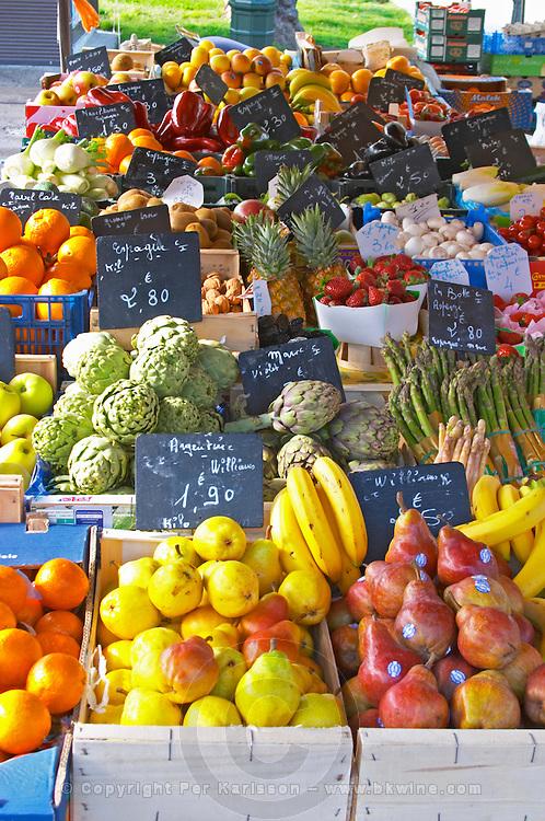 Market stalls with fruits and vegetables, apples, oranges, colourful Sanary Var Cote d'Azur France