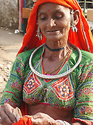Thar Desert nomad explaining how much it costs to take her photo. Camel Fair, Pushkar, Rajasthan.