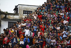 September 5, 2017 - Kathmandu, Nepal - People watch a chariot procession during Indra Jatra festival, celebrated to honor Indra, the King of Heaven and Lord of Rains in Kathmandu. Indra Jatra is the biggest religious street festival held annually in Nepal celebrated by singing, mask dancing, rejoicing and devotees offering prayers along with other rituals hold the eight-day festival celebrated by both Hindus and Buddhists. (Credit Image: © Skanda Gautam via ZUMA Wire)