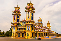 Cao Dai Great Temple in Tay Ninh, north of Ho Chi Minh City (Saigon), Vietnam. Caodaism is a monotheistic religion which mixes Taoism, Buddhism, and Confucianism.