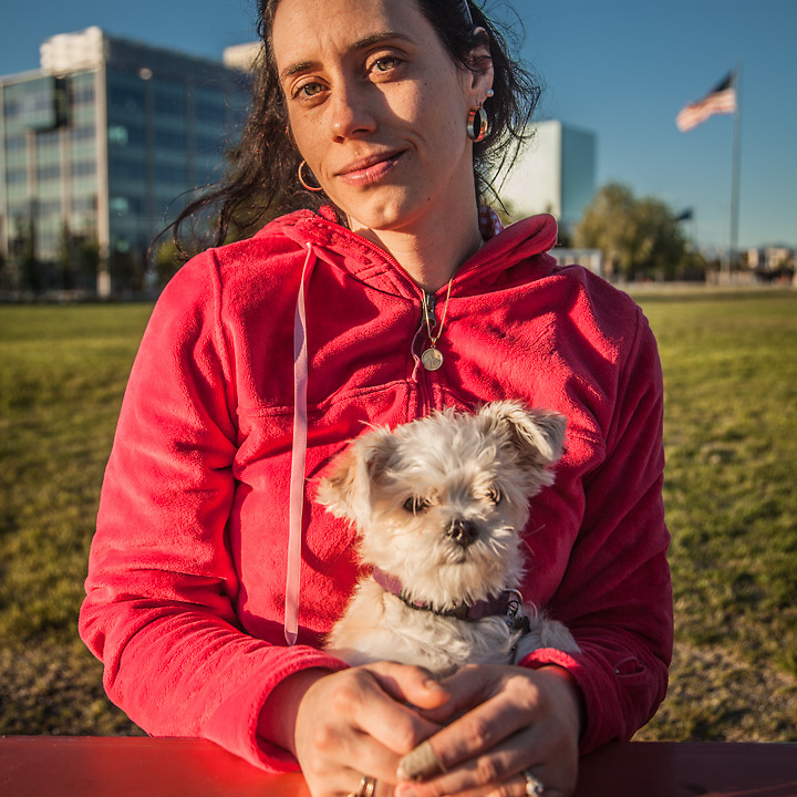 """Teacher, artist and Romani dancer Siobhan O'Hara and Cody Keim with their dogs Claire and Griffen on the Delani Park Strip, Anchorage  """"Claire is a bit freaked out…she was attacked by a labradoodle last week.""""  """"We are getting married on September 28th!"""" -Siobhan cody.keim@gmail.com"""