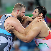Wrestling - Olympics: Day 10   Darzi Babajanzadeh, (right), of Iran in action against Eduard Popp of Germany in the Men's Greco-Roman 130 kg quarter final bout at the Carioca Arena 2 on August 15, 2016 in Rio de Janeiro, Brazil. (Photo by Tim Clayton/Corbis via Getty Images)