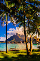 A couple kayaking on the lagoon, Four Seasons Resort Bora Bora, Motu Tehotu, Bora Bora, French Polynesia.