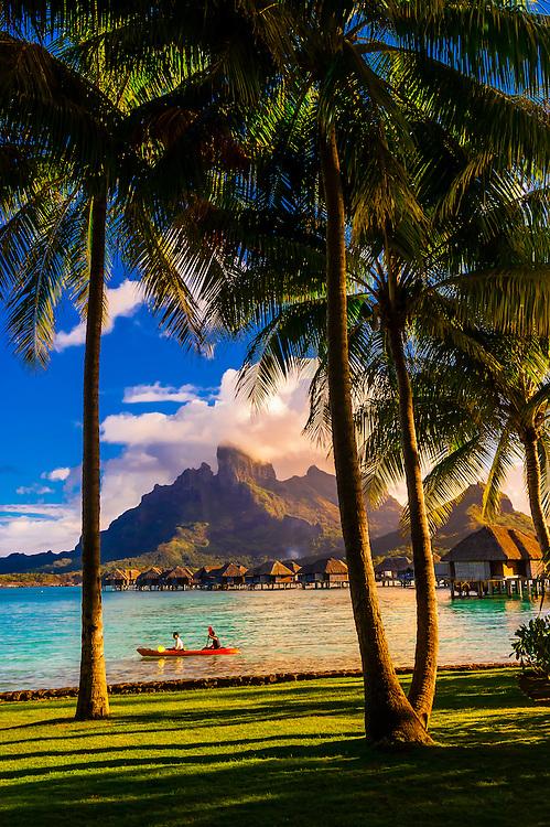 A couple kayaking on the lagoon, Four Seasons Resort Bora Bora, Motu Tehotu, Bora Bora, French Polynesia.