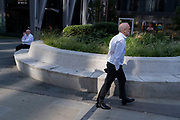 In the week that many more Londoners returned to their office workplaces after the Covid pandemic, a businessman in shirtsleeves walks through Leadenhall in the City of London, the capital's financial district, on 8th September 2021, in London, England.