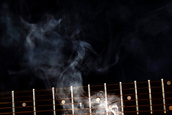 Smoke Art with the presence of a 6 string guitar