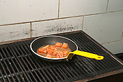 Restaurant's kitchen Salmon Cubes Sauteed on Gas stove