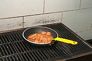Restaurant's kitchen Salmon Cubes Sauteed on Gas stove