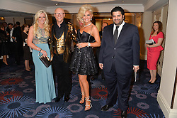 Left to right, MICHELLE MONE, JOHN & CLAIRE CAUDWELL and the Emir of Qatar (Check!) at the Caudwell Children's annual Butterfly Ball held at The Grosvenor House Hotel, Park Lane, London on 15th May 2014.