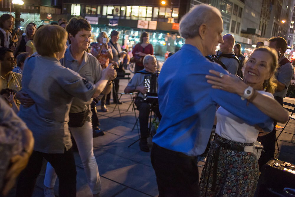 Couples dance to the music of The Old Aker Band (Gamle Aker Spelemannslag), a Norwegian accordion band, at Accordions Around the World in Bryant Park.