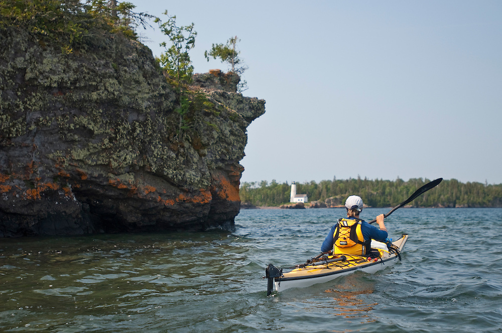 A kayaker approaches Rock Harbor Lighthouse at Isle Royale National Park.