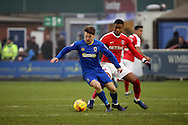 AFC Wimbledon midfielder Jake Reeves (8) screening the ball during the EFL Sky Bet League 1 match between AFC Wimbledon and Charlton Athletic at the Cherry Red Records Stadium, Kingston, England on 11 February 2017. Photo by Matthew Redman.