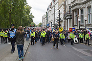 Police lead the FLA supporters during the Football Lads Alliance march between Park Lane and Westminster Bridge, London on 7 October 2017. Photo by Phil Duncan.