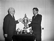 09/04/1959<br /> 04/09/1959<br /> 09 April 1959<br /> Presentation of Esso trophy to Amateur Drama Council. Esso Petroleum Company (Ireland) Ltd., presented a Solid Silver Cup and 12 replicas to the Amateur Drama Council of Ireland for the best overall group in the All-Ireland Drama Final of the Amateur  Drama Festival to be held at Athlone from 12-26th April. Picture shows Mr. T.F. Laurie, Chairman and Managing Director of Essso Ltd., (left) presenting the Esso trophy to Mr. P.J. Croal, President of the Amateur Drama Council of Ireland at the Gresham Hotel, Dublin.