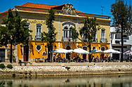 A restaurant on the Rio Gilão at lunchtime in Tavira, Portugal
