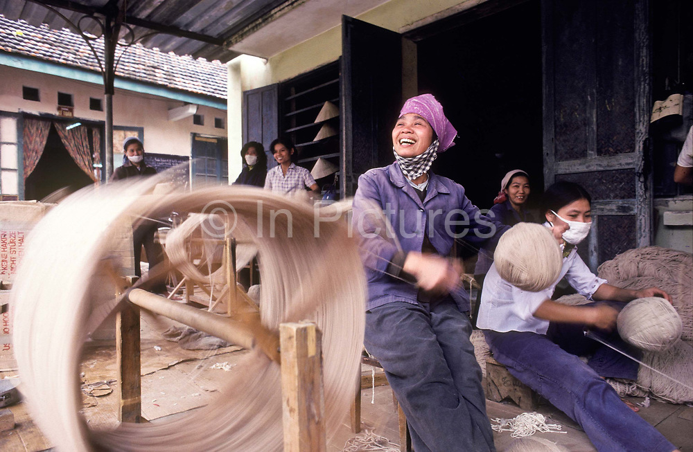 Weaving wool in a small family run cooperative, Hue city, Vietnam