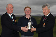 Colm Campbell (Captain Donegal GC) and John White (Chairman Ulster Golf) presents the Ulster Boys Trophy to Josh Mackin (Dundalk) on winning the Ulster Boys Championship at Donegal Golf Club, Murvagh, Donegal, Co Donegal on Friday 26th April 2019.<br /> Picture:  Thos Caffrey / www.golffile.ie