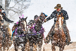 Pickup men capturing a cutter race team that wasn't yet ready to quit the race.  The cutter races are put on by the Shriners in Afton Wyoming for a fundraiser for Children's Health Care. <br /> <br /> Races are held on Presidents Weekend every year in Afton Wyoming