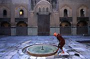MOROCCO: Fes.Washing feet before prayer, inside an old medersa (Islamic university)