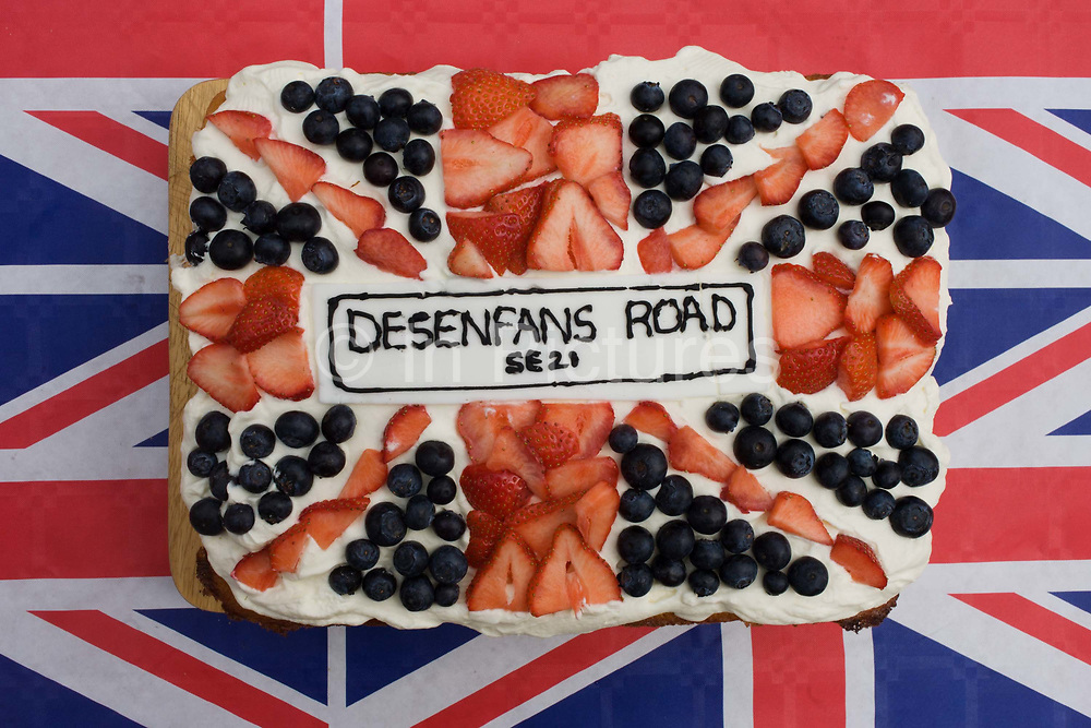 Road name on decorated sponge cake at a neighbourhood street party in Dulwich, south London celebrating the Diamond Jubilee of Queen Elizabeth. A few months before the Olympics come to London, a multi-cultural UK is gearing up for a weekend and summer of pomp and patriotic fervour as their monarch celebrates 60 years on the throne and across Britain, flags and Union Jack bunting adorn towns and villages.