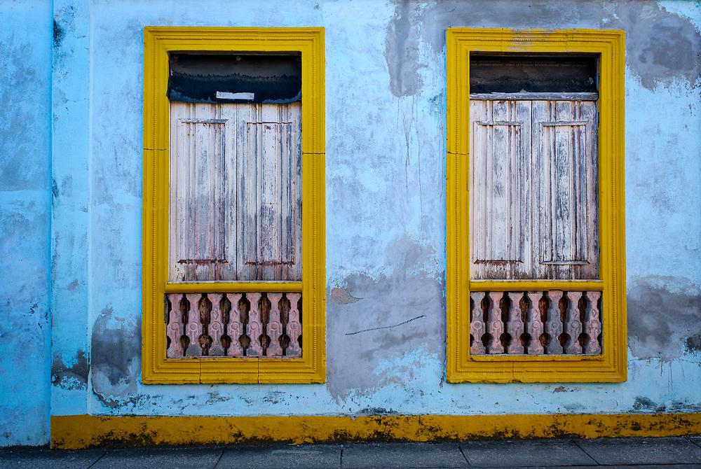 BARACOA, CUBA - CIRCA JANUARY 2020: Typical windows on the street of Baracoa.