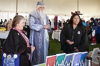 Hogwarts students Frances Selkirk of North Reading, MA and Richeau Breland of Queens, NY with Jeff Peterson of Oxford, Michigan as Professor Albus Dumbledore join Harry Potter wizardry fans at the Misti-Con 2015 held at the Margate Resort Saturday afternoon.  (Karen Bobotas/for the Laconia Daily Sun)