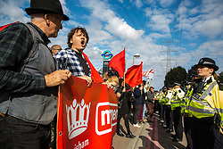 London, UK. 7 September, 2019. Metropolitan Police officers form a cordon in front of Momentum activists taking part in a sixth day of Stop The Arms Fair protests outside ExCel London against DSEI, the world's largest arms fair. The sixth day of protests was billed as a Festival of Resistance and included performances, entertainment for children and workshops as well as activities intended to disrupt deliveries to ExCel London for the arms fair.