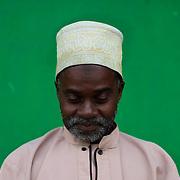 An Imam is seen reading the Quran during the first day of Ramadan in a multi-religious neighbourhood in Bujumbura, Burundi.