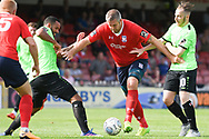 Jon Parkin of York City (9) scores a goal to make the score 1-1 during the Vanarama National League North match between York City and Curzon Ashton at Bootham Crescent, York, England on 18 August 2018.
