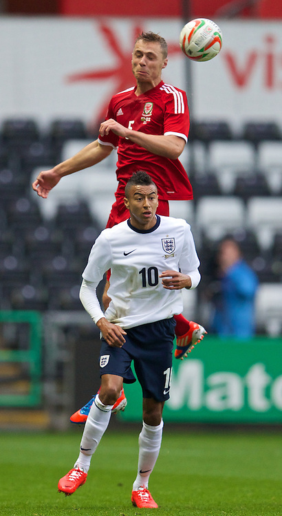 SWANSEA, WALES - Monday, May 19, 2014: Wales' George Ray in action against England's Jesse Lingard during the 2015 UEFA European Under-21 Championship Qualifying Group 1 match at the Liberty Stadium. (Pic by David Rawcliffe/Propaganda)