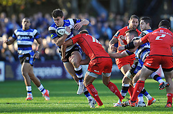 Ollie Devoto of Bath Rugby takes on the Toulouse defence - Photo mandatory by-line: Patrick Khachfe/JMP - Mobile: 07966 386802 25/10/2014 - SPORT - RUGBY UNION - Bath - The Recreation Ground - Bath Rugby v Toulouse - European Rugby Champions Cup