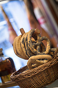 Close-up of bagels in basket for sale in cafe, Trieste, Italy