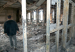 © under license to London News Pictures. 24/02/2011. A man walks through a destroyed room at Muarmar Gadaffi's former palace in the Army Compound in the Libyan city of Benghazi. Photo credit should read Michael Graae/London News Pictures