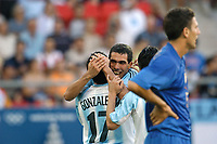 24/08/04 - ATHENS - GREECE -  - OLYMPIC FOOTBALL - SEMIFINALS - MENS  -  <br />ITALY VS. ARGENTINA ().<br />At Karaiskaki Stadium in Faliro / Athens<br />Argentine N*17 MARIANO GONZALEZ celebrating his goal with N*10 CARLOS TEVEZ who did one and assist hi in this.<br />(In front) ITALIAN PLAYER N*5 BONERA DANIELE.<br />© Gabriel Piko / Argenpress.com / Piko-Press