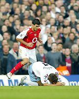 16/10/2004<br />FA Barclays Premiership - Arsenal v Aston Villa - HIghbury<br />Arsenal's Jose Antonio Reyes steps over Aston Villa's Lee Hendrie after apparently touching heads during an argument<br />Photo:Jed Leicester/BPI (back page images)