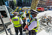 Police Detained a member of Extinction Rebellion Youth Cambridge who participated in a roadblock protest action outside Baringa Partners building in London on Thursday, Sept 10, 2020 - in an attempt to highlight the involvement of Schlumberger Limited in what they call 'ecocide'. Schlumberger is an oilfield services company working in more than 120 countries and has four principal executive offices located in Paris, Houston, London, and The Hague. An article at the Guardian suggests that it's ubiquitous in fossil fuel operations across the world, has more staff than Google, turns over more than Goldman Sachs, and is worth more than McDonald's – yet you won't have heard of it. XR Youth of Cambridge said that the British government gave 'Schlumberger' a no-strings-attached £150 million bailout loan as it was laying off a fifth of its global workforce. Another activist added: 'Schlumberger is hiding in plain sight here in Westminster. Every day, hundreds of people walk past this building with no idea that they're on the doorstep of a climate crime scene.'<br /> Environmental nonviolent activists group Extinction Rebellion enters its 10th and final day of continuous ten days protests to disrupt political institutions throughout peaceful actions swarming central London into a standoff, demanding that central government obeys and delivers Climate Emergency bill. (VXP Photo/ Vudi Xhymshiti)