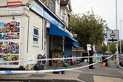 © Licensed to London News Pictures. 27/04/2020. London, UK. A police officer guards a crime scene outside an address on Aldborough Road North in Ilford where two children were stabbed to death and a 40 year old man suffered knife injuries last night . Photo credit: George Cracknell Wright/LNP