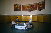 Children playing inside the Miami post office with safety deposit boxes, on 15th May 1996, in Miami Beach, Florida, USA.