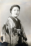 young adult Japanese woman waering traditional kimono portrait ca 1950s