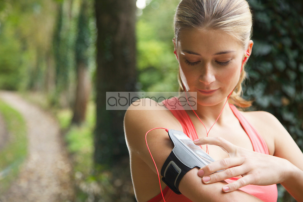 Woman Preparing Mp3 player for Work-out