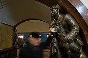 Moscow, Russia, 05/12/2007...The Moscow Metro underground transport system, renowned for its' spectacular Soviet architecture: socialist statues on the platforms at Ploschad Revolutsii  [Revolution Square] station. The brass of the dog's nose has been worn bare by superstitious commuters rubbing it for good luck as they pass.