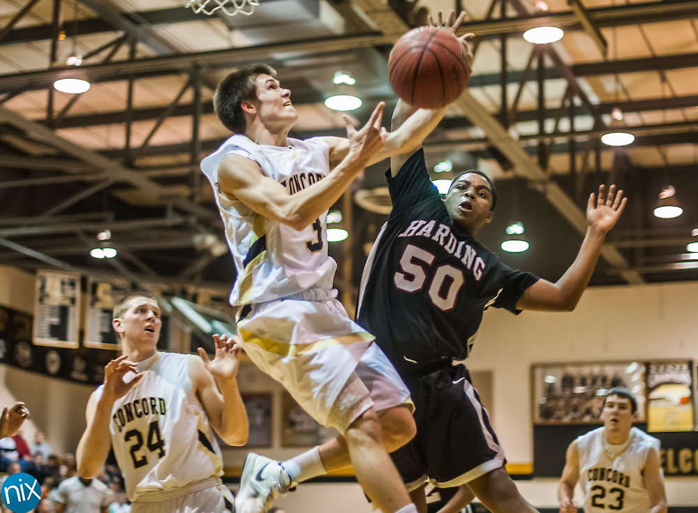 Concord's Greg Childress goes up for a shot against Harding's Rashaad Richardson during the third round of the NCHSAA 3A playoffs Friday night at Concord High School. Harding defeated the Spiders 71-65.
