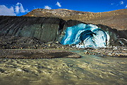 Blue ice and melt water at the toe of the Athabasca Glacier, Jasper National Park, Alberta, Canada