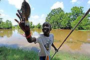 Eight year old Montrell Lydia is thrilled about having caught a sunfish during the UTHSCT hosted annual asthma camp at Camp Tyler on Tuesday. photo: Jaime R. Carrero/Tyler Morning Telegraph