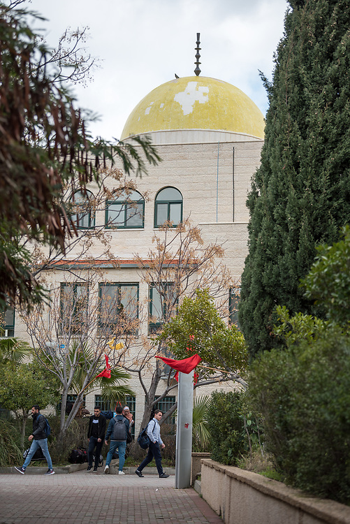 26 February 2020, Abu Dis, Palestine: Students go about their day outside the mosque at Al-Quds University in Abu Dis.